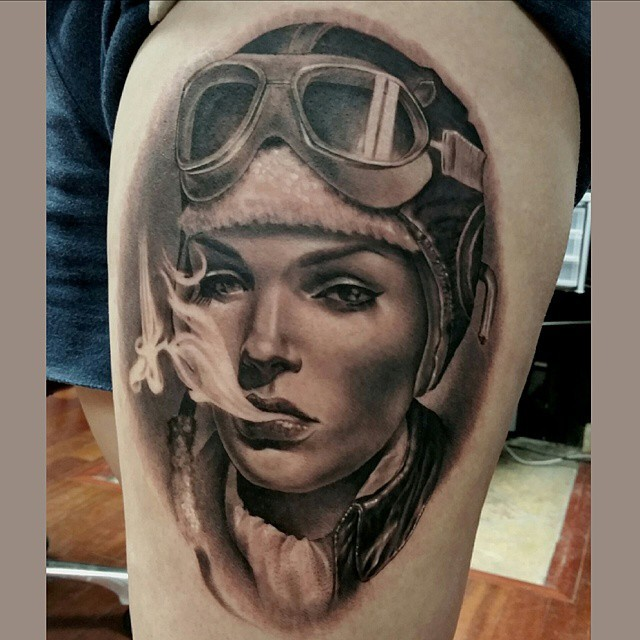 Amazing magnificent thigh tattoo of smoking woman portrait