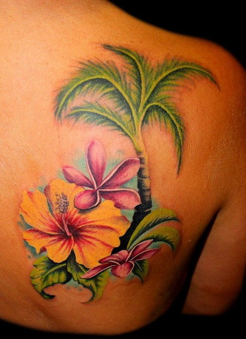 Amazing tropical flowers with palm tattoo on back