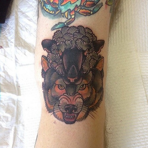 Amazing wolf in sheep skin tattoo on arm