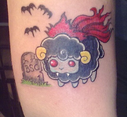 Amuse colorful vampire sheep tattoo on arm