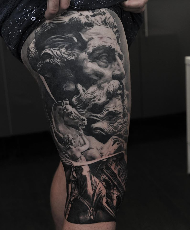 Ancient statue face tattoo on leg sleeve