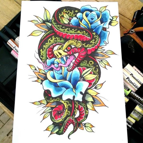 Angry green snake and blue roses tattoo design