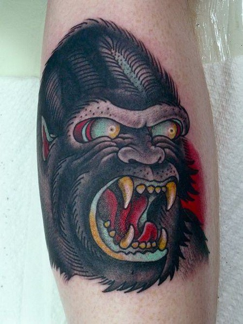 Angry old school color-ink gnarling gorilla head tattoo on arm