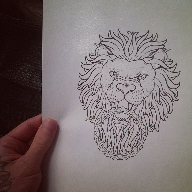 Angry uncolored lion keeping a ring in teeth tattoo design