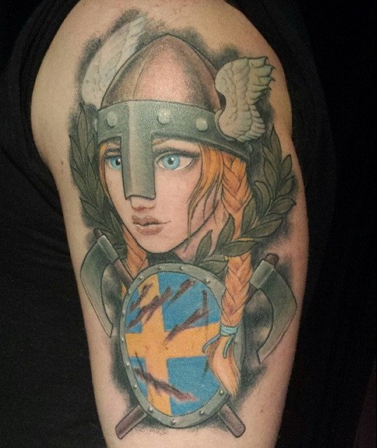 Animated Viking girl tattoo on shoulder