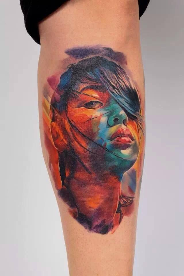 Asian style colored tattoo of woman portrait stylized with scars