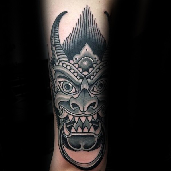 Asian traditional black ink arm tattoo of gargoyle head