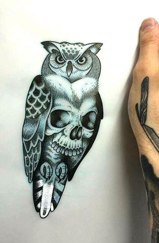 Attractive blue-shining owl with skull pattern tattoo design