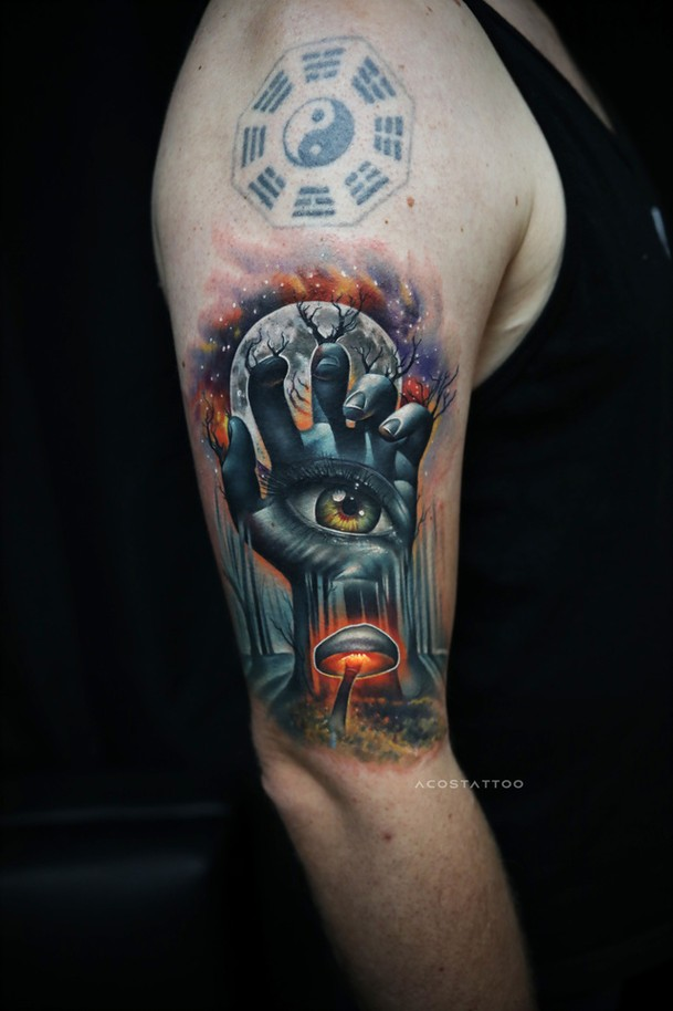 Awesome abstract hand with eye tattoo on shoulder