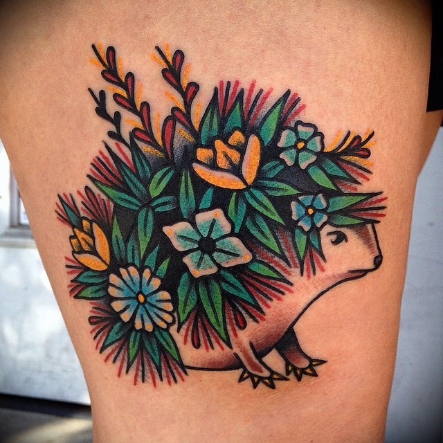 Awesome animated flowered hedgehog tattoo on thigh