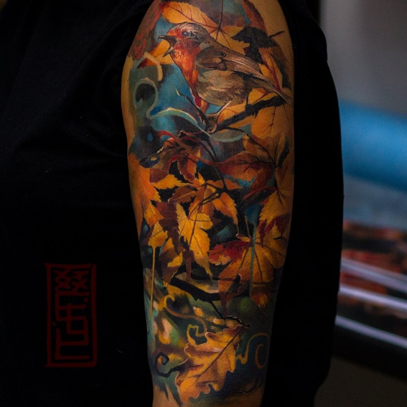 Awesome bird tattoo and autumn motifs