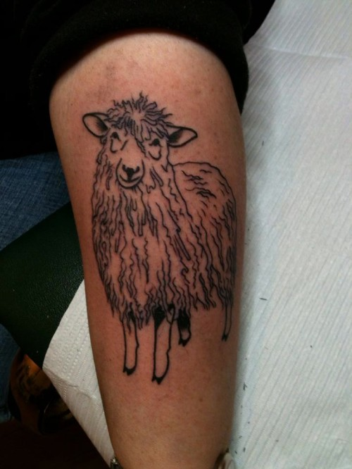 Awesome black-ink sheep tattoo on arm