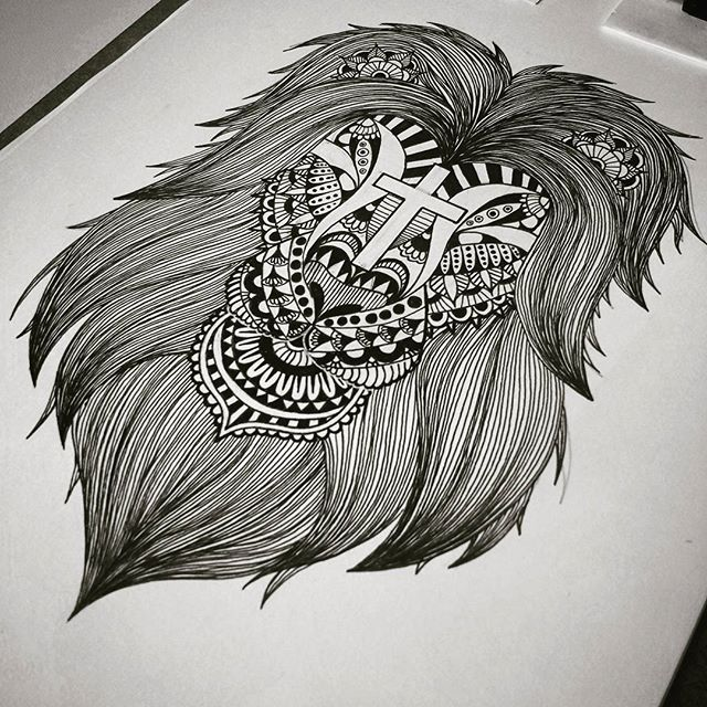 Awesome black ornamented lion with reversed cross on forehead tattoo design