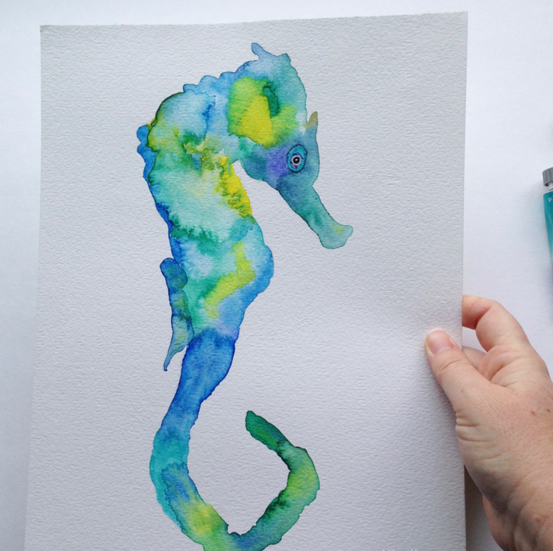 Awesome blue-and-yellow watercolor seahorse tattoo design