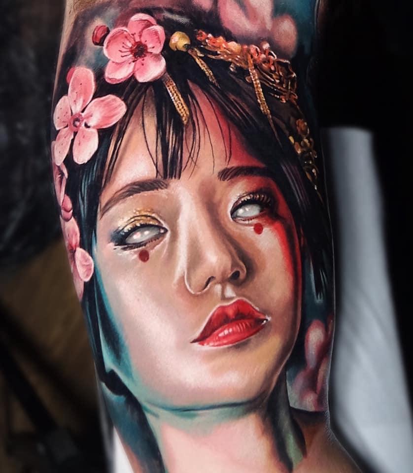 Awesome colorful Geisha portrait tattoo