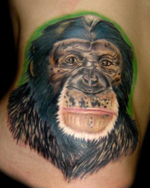Awesome colorful chimpanzee muzzle portrait tattoo on hip