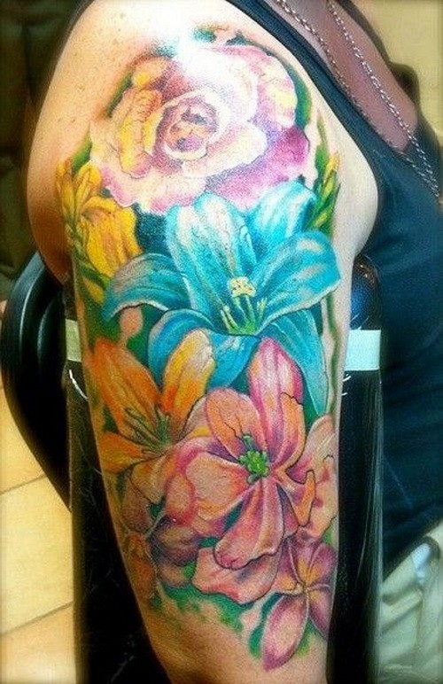 Awesome colorful tropical flowers tattoo on upper arm