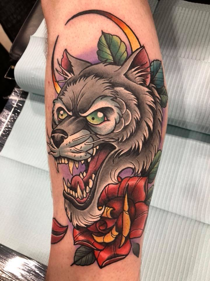 Awesome colorful wolf head tattoo on arm