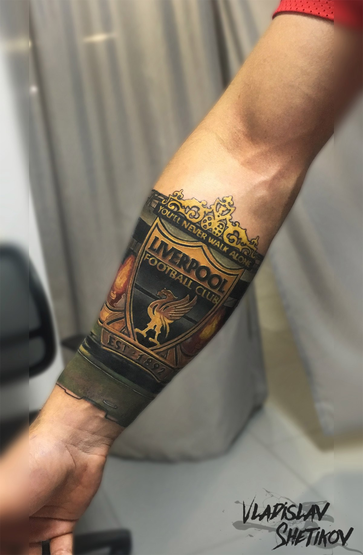 Awesome colorfull tattoo with Liverpoll football club logo