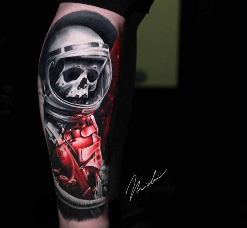 Awesome dead astronaut tattoo on arm by Michaël Cloutier ...