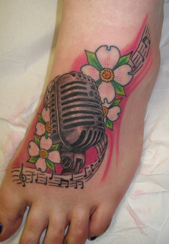 Awesome dogwood flowers and microphone tattoo on foot