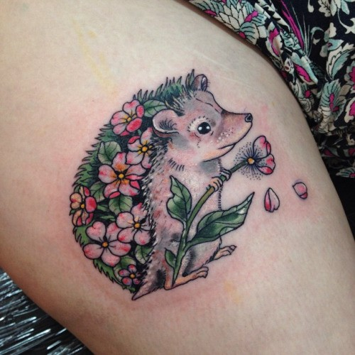 Awesome girly colorful hedgehog with pink flowers tattoo on thigh