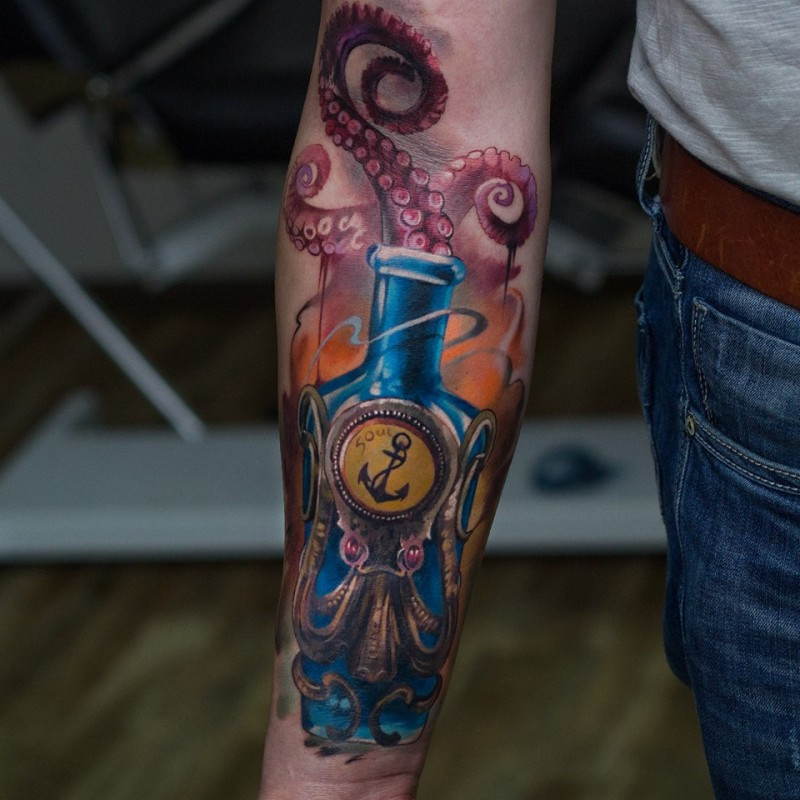 Awesome octopus in bottle tattoo on forearm