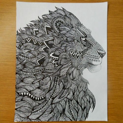 Awesome ornamented lion portrait in profile tattoo design