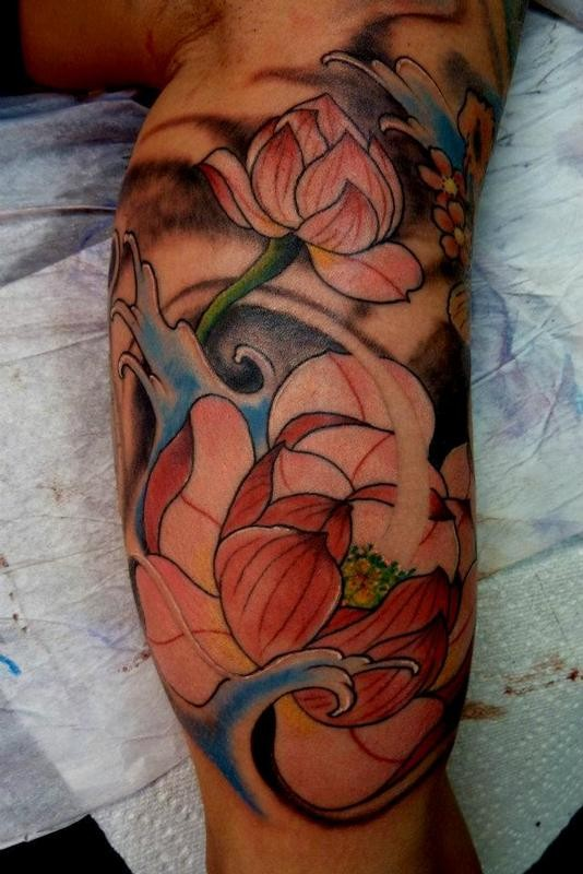 Awesome pale pink japanese lotus flowers in waves tattoo for Japanese wave and flower tattoo