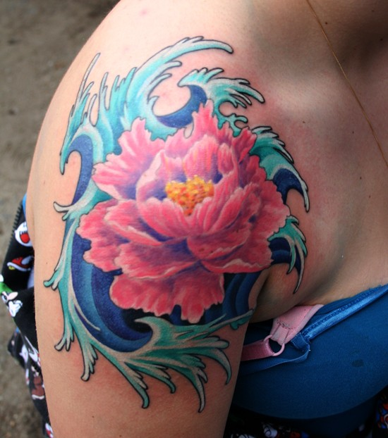 Awesome pink japanese flower in blue waves tattoo on shoulder