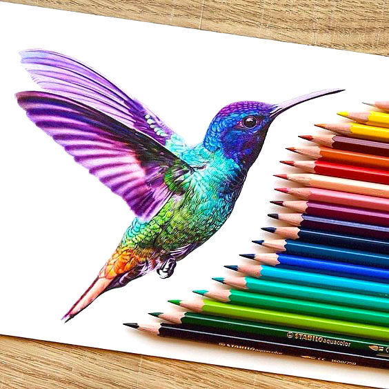Awesome rainbow watercolor hummingbird tattoo design