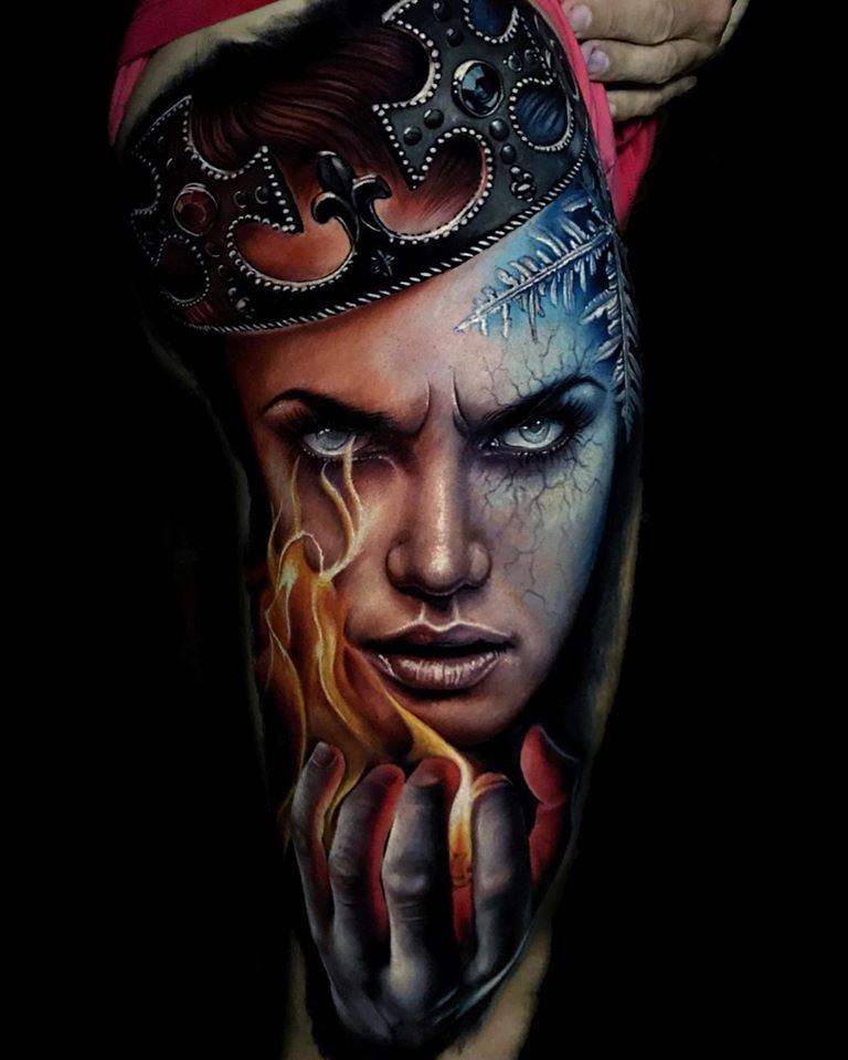 Awesome realistic face tattoo with hot and cold motives