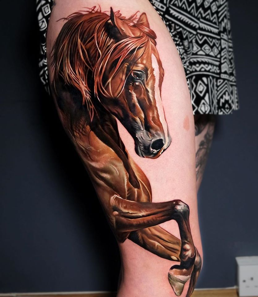 Awesome realistic horse tattoo on leg
