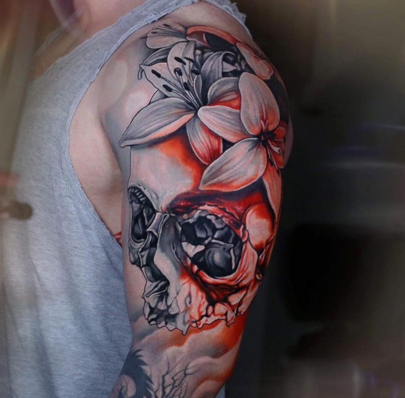 Awesome skull and flowers tattoo on shoulder