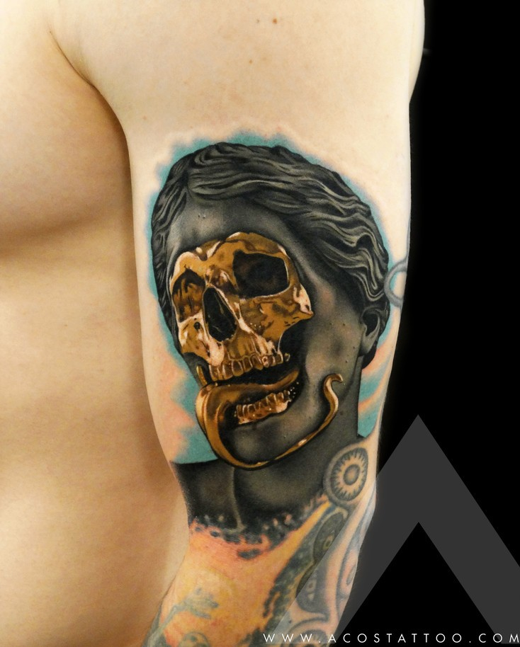 Awesome statue with skull golden mask tattoo on arm