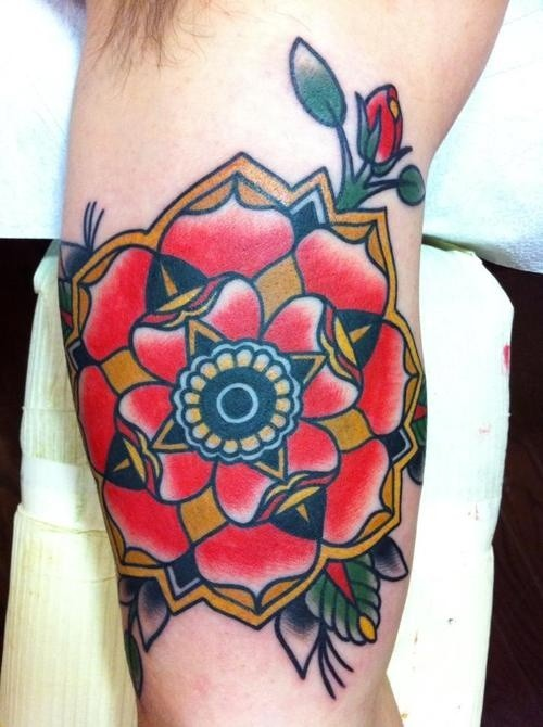 Awesome traditional old school flower tattoo on upper arm