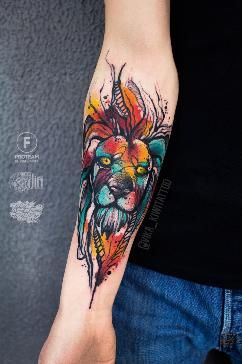 Awesome watercolor lion tattoo on forearm