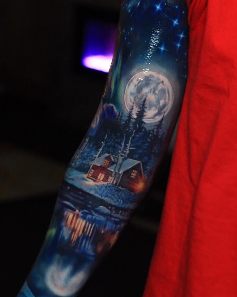 Awesome winter night tattoo on arm