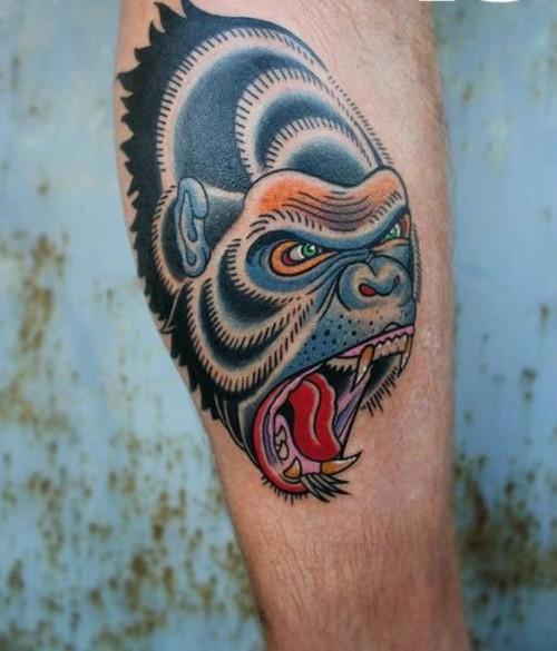 Awesomeold school colorful gorilla head tattoo on arm