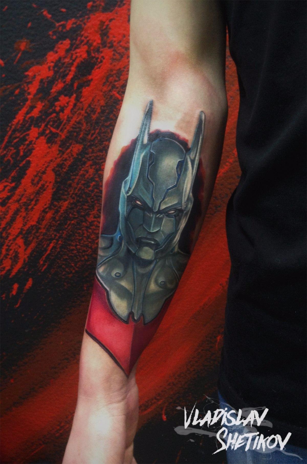 Batman head tattoo on forearm
