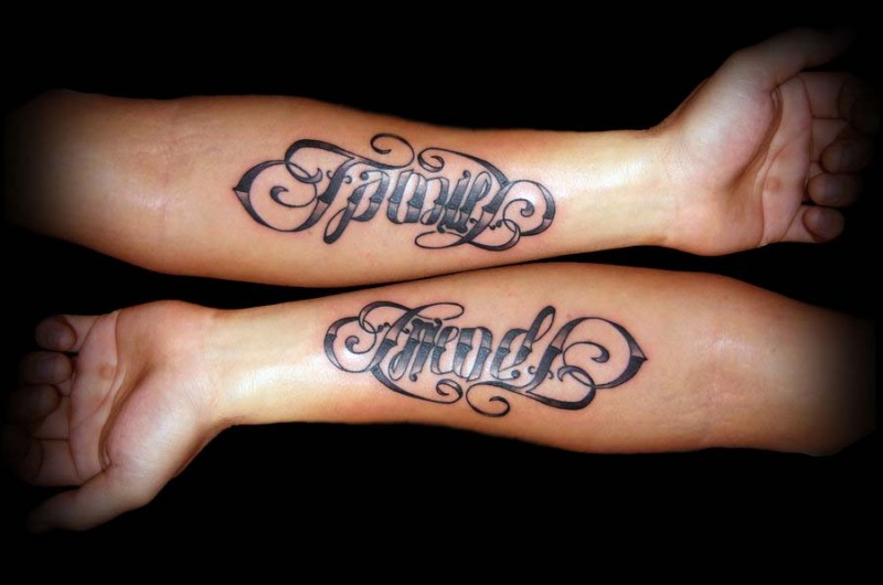 Beautiful black-and-white family and friends quote tattoo on arm