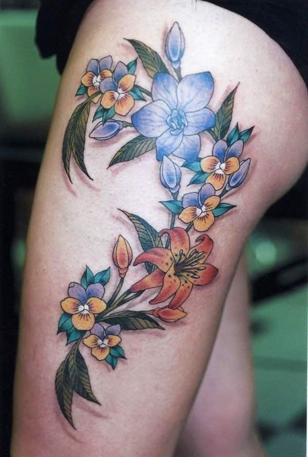 Beautiful colorful flower tattoo for girls on thigh