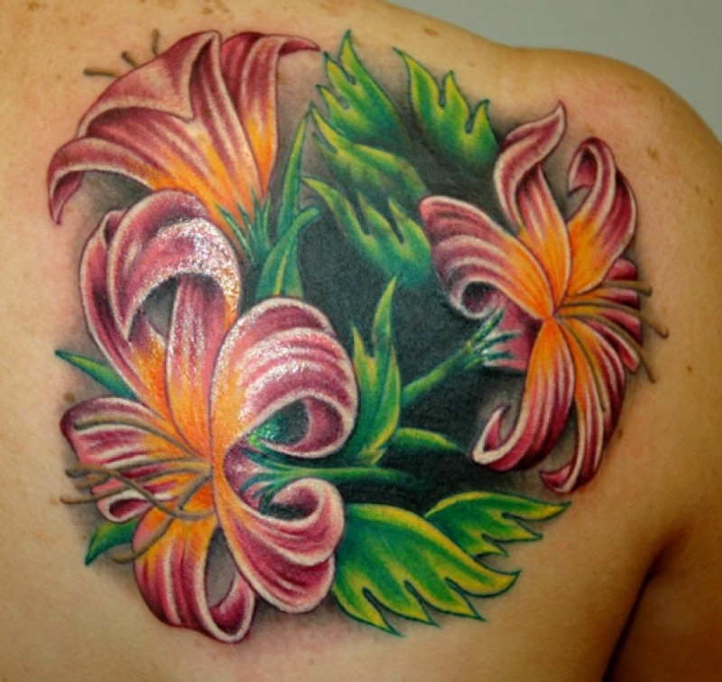 Beautiful colorful tropical flowers tattoo on back