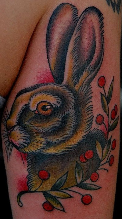 Beautiful old school hare with branch of berries tattoo on shin