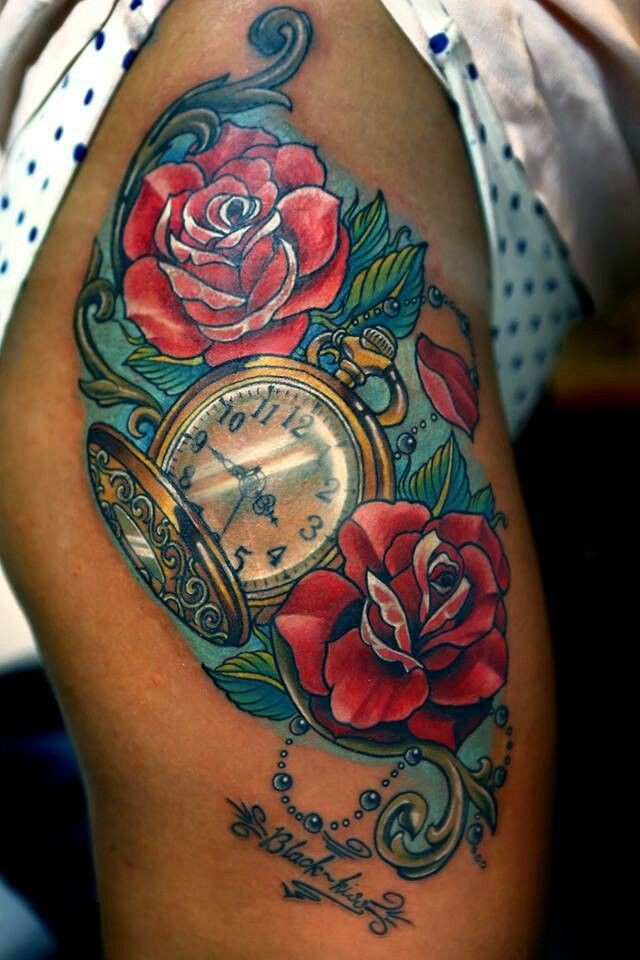 Beautiful red rose flowers and watch tattoo on thigh