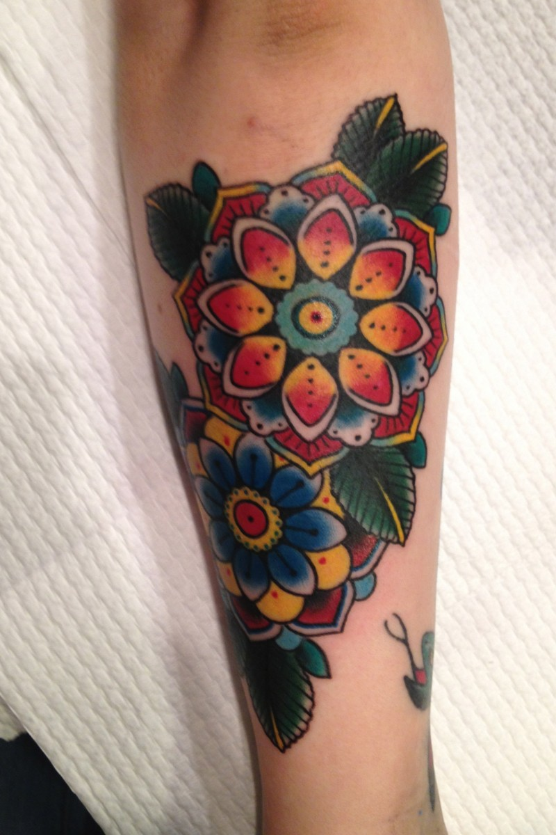 Beautiful traditional old school colorful flowers tattoo on arm
