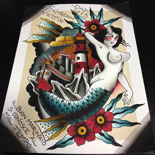 Big old school mermaid with turquoise tail surrounded with flowers and ship tattoo design