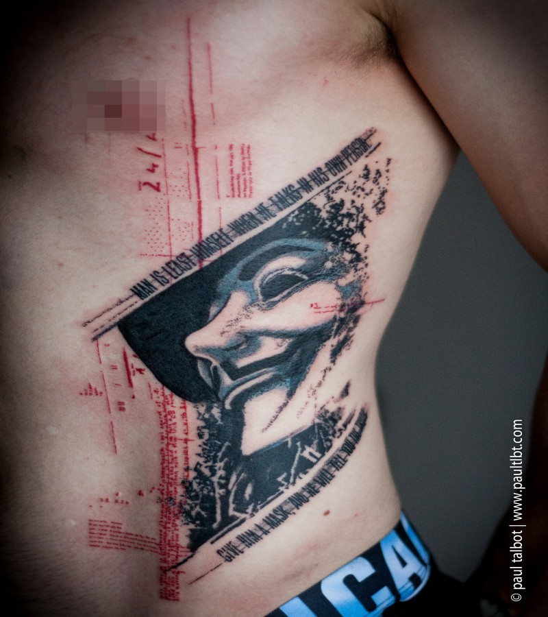 Big trash polka style side tattoo of Anonimous mask with lettering