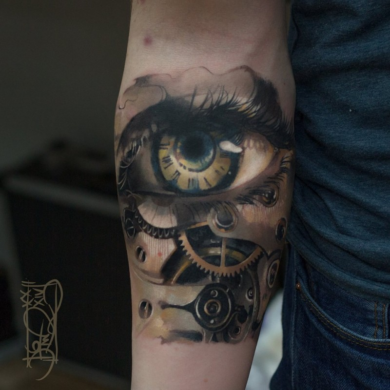 Biomechanical eye tattoo on forearm