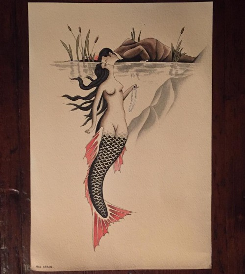 Black-and-red tail mermaid kissing a man under water tattoo design